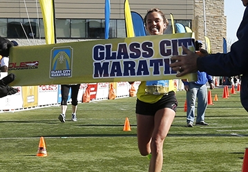 CTY marathon27p   Samantha Bluske, of Toledo, is the first female finisher of the marathon.    The Glass City Marathon in Toledo, Ohio on April 25, 2015. The events include a marathon, a 5 Person Marathon Relay, a half marathon, and a 5K.   The Blade/Jetta Fraser